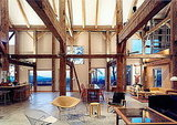 This massive, 4,500-square-foot home's interior contains a transported, restored, and re-erected Dutch barn frame. Source