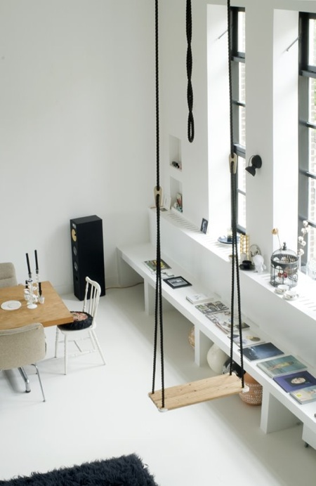 A converted loft with soaring ceilings is just begging for a swing.  Source