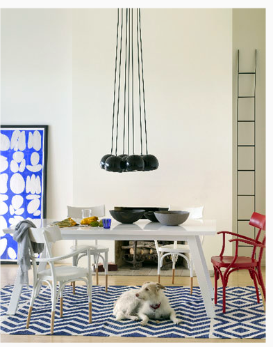 Stylist Lili Diallo's use of bright, primary colors, as well as her playful use of dimension in this tall space, really pull this room together.  Source
