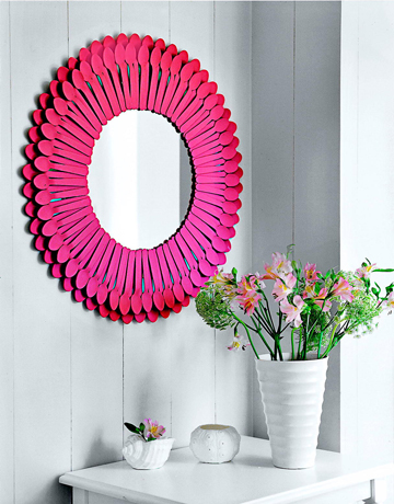 Turn plastic spoons into this charming mirror.
