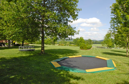 Alan Jackson protected the beautiful views on his sprawling Sweetbriar Estate by hiding his kids' trampoline eyesore in the ground. This trick also makes jumping safer, since they've got a shorter distance to fall.  Source