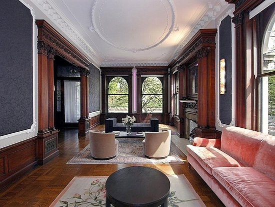 Jennifer Connelly and Paul Bettany drew attention to the beautiful oval ceiling molding in their Brooklyn townhouse by mimicking it with round furnishings.   Source