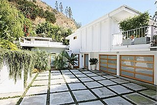 The cement tiling in the driveway of John Krasinski's Hollywood home gives the space a great graphic quality.   Source