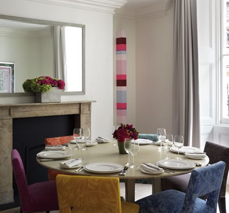 If your dining room or kitchen is otherwise neutral, upholster each of your chairs in a different fabric in complementary colors, or the same fabric in each of its colorways, to give the room a playful edge. You can get away with it if the space isn't already busy.