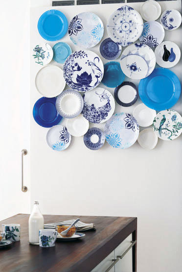 I will always have a soft spot in my heart for blue plates. My grandmother collects Danish blue plates, and I used mismatched blue-patterned plates for my wedding dinner. This is a great idea for displaying a group of similarly colored plates in a modern fashion.  Source
