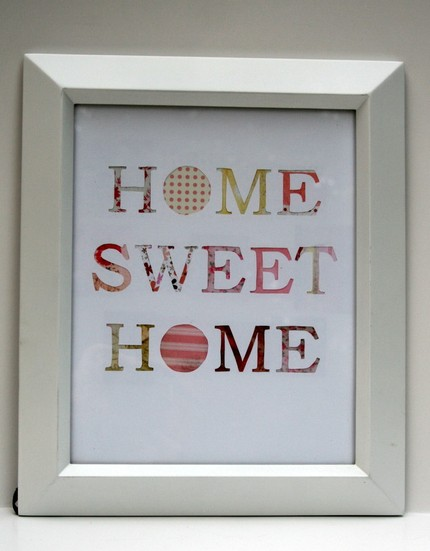 The letters of this framed piece ($50) are hand-cut, exposing charming patterned papers below.