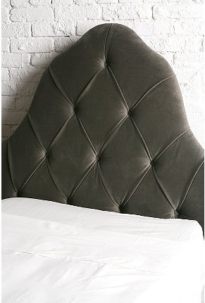 The Urban Outfitters Twin Velvet Tufted Headboard ($280) is a great update to the movie's princess headboard.