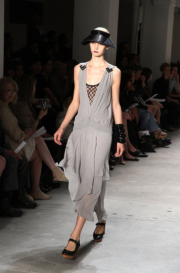 A sliver of criss-cross work is enticing peeking out from this long dress.