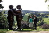 """Dancers"" by artist Fernando Botero adorns the grounds of the garden, as the Duke and Duchess of Devonshire look on."