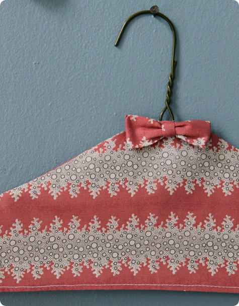 Design*Sponge shows you that wire doesn't have to be so ugly when you turn it into fabric-covered hangers.