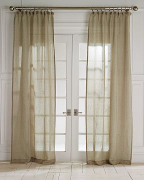 Try the Williams-Sonoma Sheer Linen Flat Top Drapes ($125-$150) for a similar effect.