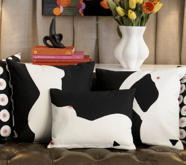 Jonathan Adler's Front Lady Pillow ($125) features a nude silhouette on one side and rows of hand-embroidered nipples on the other. Now there's an icebreaker.
