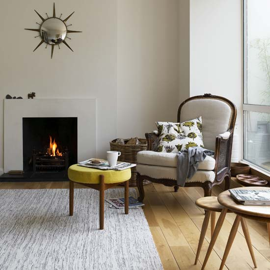Pull up a chair and cozy throw close to your fireplace to take advantage of Autumn mornings.  Source
