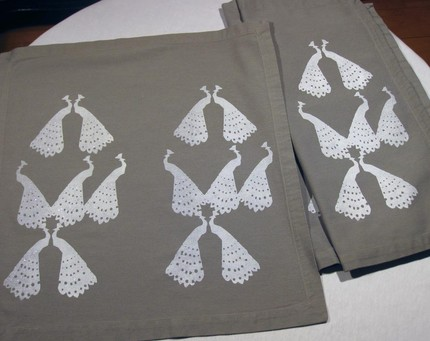 This gray cotton Sparkling Peacock Napkin Set ($25 for four) from Luxville is hand screenprinted and lightly flocked with glitter for a seriously glamorous tabletop.
