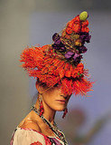 The colorful, Chiquita banana lady-style hat is very wild, but its orange fringe base would translate well to interiors.