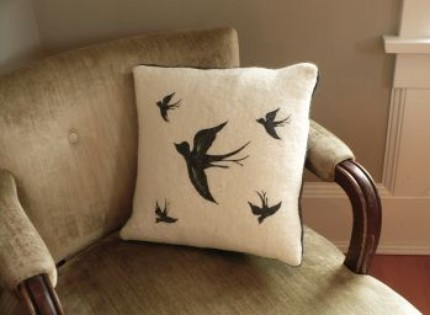 This Sparrow Cushion ($95) is made from silk and wool, and features charcoal wool with piped green buttonholes and wooden buttons on the back.