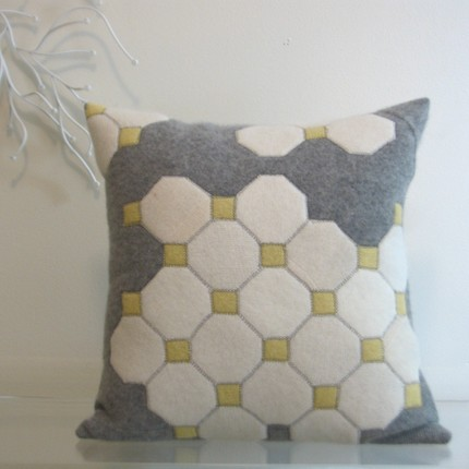 The Octagon Tiles Pillow ($98) is handmade from recycled, felted sweaters. I love its video game feel.