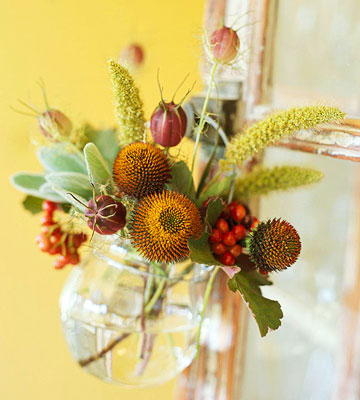 Hang Fall blooms and berries from a suspended vase. Source