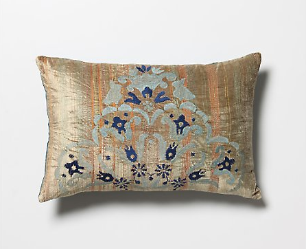 The colors and gold sheen of this Aydin Pillow ($118) feature antique Turkish velvet, bedecked with textural topstitching, embroidered fronds, and fan-tipped leaves. It matches the dress perfectly.
