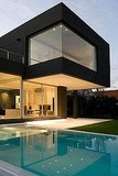 This modern, angular black house is located outside of Buenos Aires. It was designed by Andres Remy Arquitectos.
