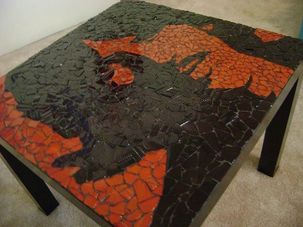 This Stained Glass Mosaic Table ($185) showcases a classic image of George Harrison.