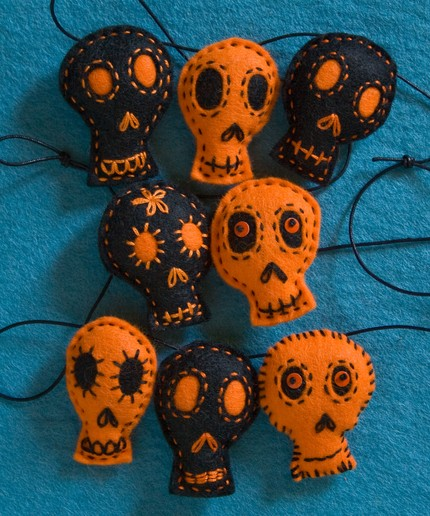 This Small Black and Orange Skull Garland ($40) is hand-cut, hand-embroidered, and hand-stuffed. One of a kind and totally cute!