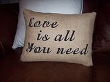"Here's another take on ""Love is all you need,"" in the form of a Decorative Burlap Pillow ($20)."