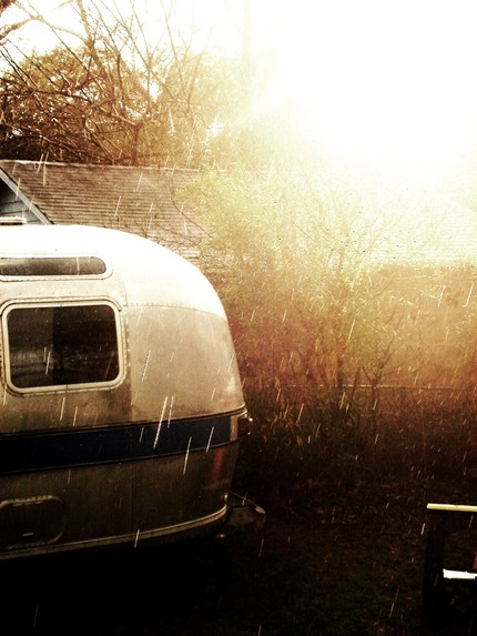 I love the moody, sepia tone colors in this Airstream Rain print ($30).