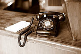 A rotary phone can add classic style to any space. This one was found in a San Francisco restaurant. 