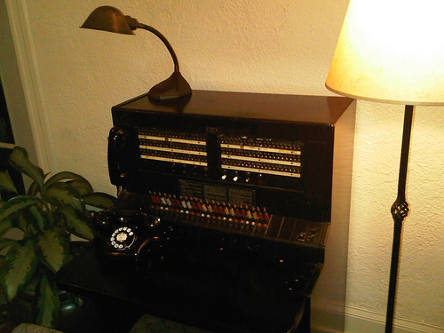 Go for an entirely retro look with a rotary phone and a switchboard, like this one in the lobby of the Cardinal Hotel in Palo Alto, CA.  Source:  Flickr User Ethan Prater