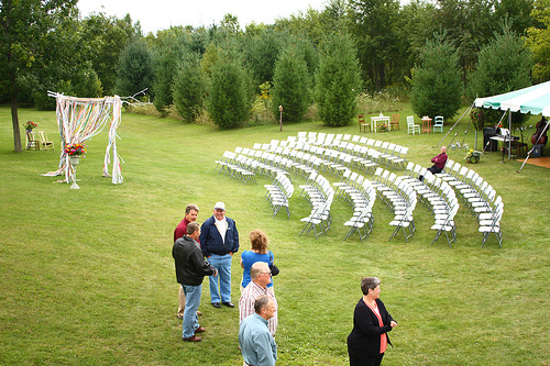 The wedding took place in Jamie's family's backyard, a Wisconsin country home where she grew up. Jamie and her husband, who are both artists, made the arbor together as a collaboration installation.