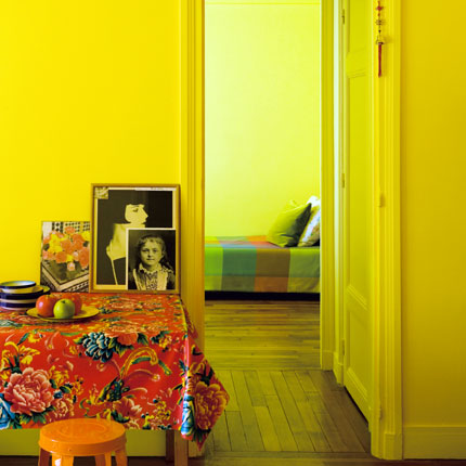 A room that gets a lot of natural light is an ideal place to paint the walls and trim in yellow, since the light infuses the space with an ethereal, vintage glow. Source