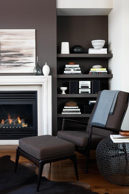 These rich, dark chocolate walls look lush, warm, and inviting — as does that fire!  Source