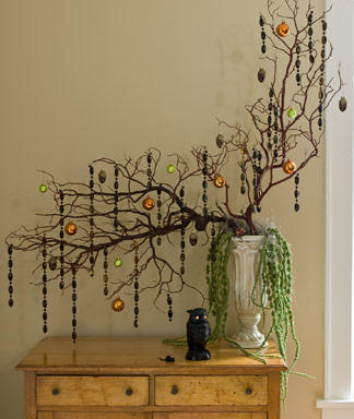 Go glam this Halloween with this decorated branch arrangement from Woman's Day.