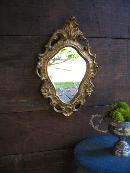 This Antique Italian Rococo ($48) is gold with lots of aged colors in its grooves and swirls.
