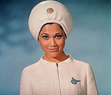 This Pan Am stewardess looks like the Amazing Kreskin. I wonder if she reads minds, too.