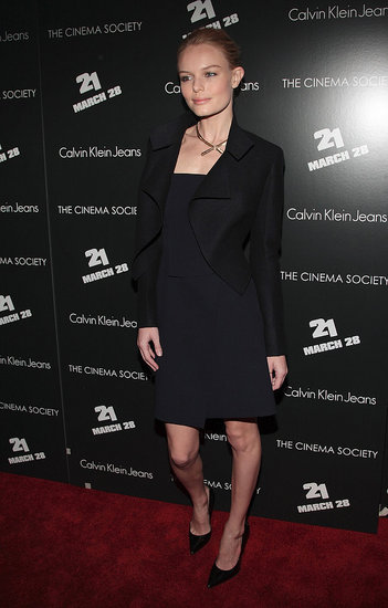 Classy as ever in a black strapless Calvin Klein dress and a black jacket at the premiere of 21.