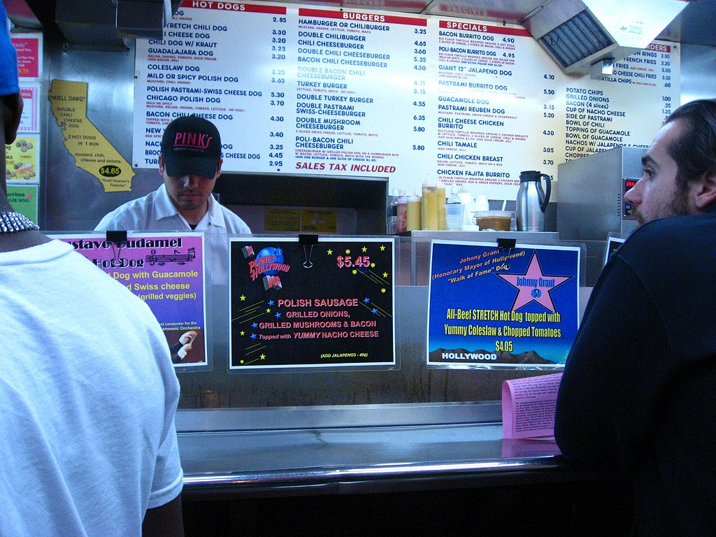 "This is the main counter. You don't order here, you sort of sidle along and watch them make the people in front of you's orders. Note the menu in the back. I sort of wished I ordered the Pastrami Burrito Dog. Okay maybe more than ""sort of."""