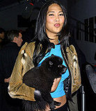 Model Kimora Lee Simmons with her dog, Zoe, attend the Sean John Fall 2001 collection show at New York's Fashion Week on Februar