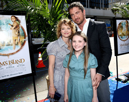 Abigail Breslin and her co–stars Jodie Foster and Gerard Butler at the blue carpet premiere of Nim's Island.