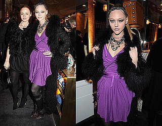 Model Sasha Pivarova Attends The Parisian Stella McCartney Store Opening in Purple Wrap Dress