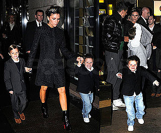 Photos of Victoria Beckham in Milan with Cruz, Brooklyn, Romeo in Suits