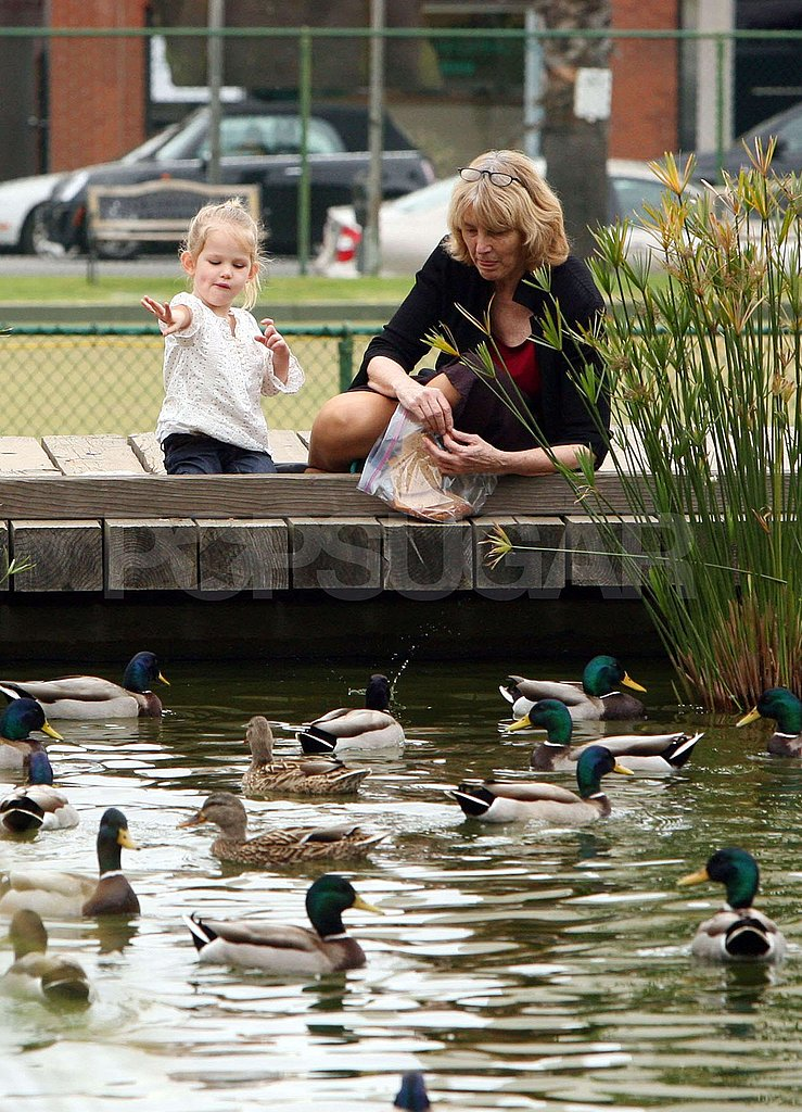 Violet Feeds the Ducks