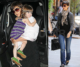 Katie Has Her Hands Full of Suri and Designer Bags
