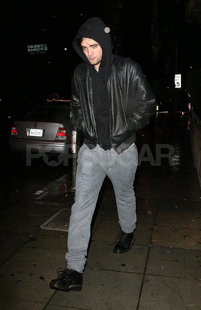 Robert Pattinson Gets Caught in the Rain