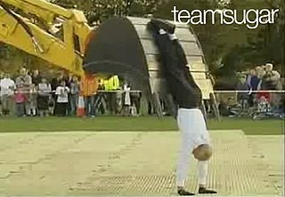 Man Dances With Bulldozer