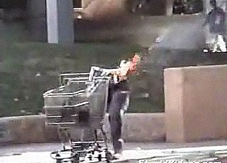 Torso-less Robot Legs Push A Shopping Cart Down the Street
