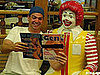 Man Poses With Ronald McDonald and Porn