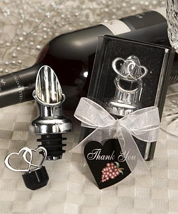 "For the wine fans, try this heart-themed wine pourer/stopper. If you don't like hearts, don't miss out on this dollar sign ""for richer or pourer"" version."