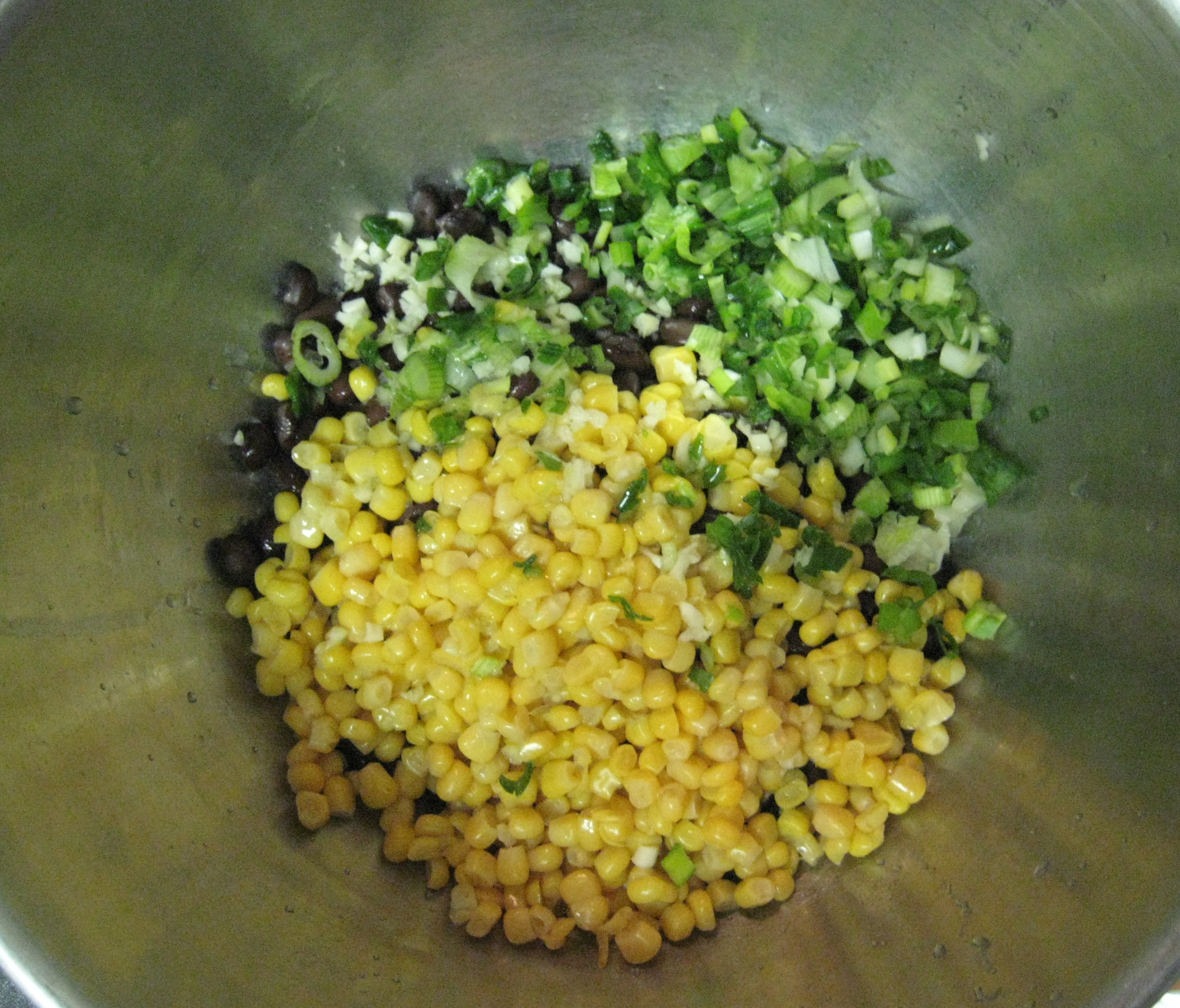 Mixing the corn black bean salad.